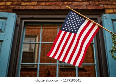 A US flag as seen from the street as it hangs from a lamp post in Philadelphia, PA.
