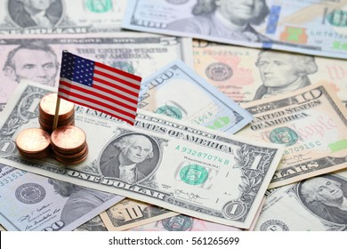 US flag sign and Dollar cash banknote and coin background, USA finance and economy concept