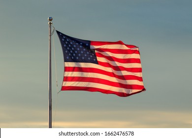 U.S. Flag and Sky at Sunset - Shutterstock ID 1662476578