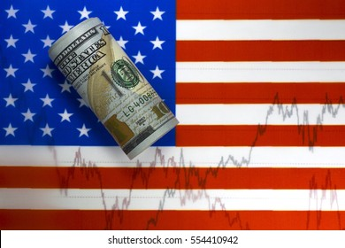 US flag. Stock market prices chart under the flag. Rolled one hundred us dollar bill lying diagonally on the stars. Two lines on the diagram. Concept of stock market trading.