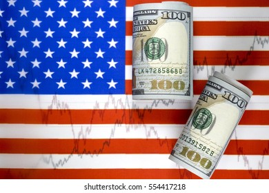 US flag. Stock market prices chart under the flag. Rolled one hundred us dollar bill lying  on the flag. Two lines on the diagram. Concept of stock market trading.