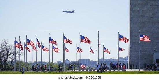 US Flags around the Washington Monument - WASHINGTON / DISTRICT OF COLUMBIA - APRIL 8, 2017