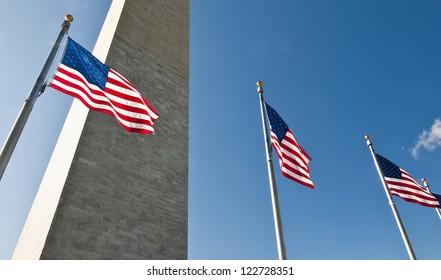 US flags and Washington Monument, DC USA