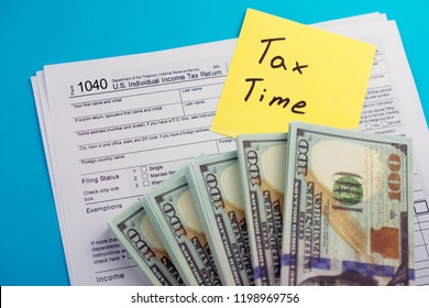 U.S. Individual income tax return. TAX DEDUCTIONS and individual tax return form 1040 with money on table. Lodging your tax return.