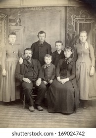 US - IOWA - CIRCA 1885 - A vintage antique photo of a family of seven. The mother and father are sitting with their five children standing behind. A photo is from the Victorian era. CIRCA 1885