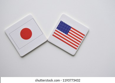US and Japan flags on white background. copy space