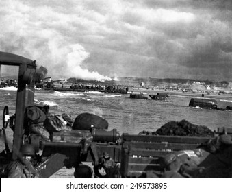 U.S. landing craft approaching Omaha Beach in Normandy beach on Dec. 6, 1944. Soldiers are standing on ships decks, indicating heavy German resistance had ceased. France, World War 2.