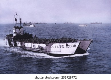 U.S. Landing crafts loaded with soldiers moving toward the Normandy beaches on June 7, 1944. After the D-Day landings, soldiers and supplies poured into France during WW2. B&W Photo with oil color.