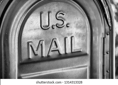 US Mail written on a mailbox.
