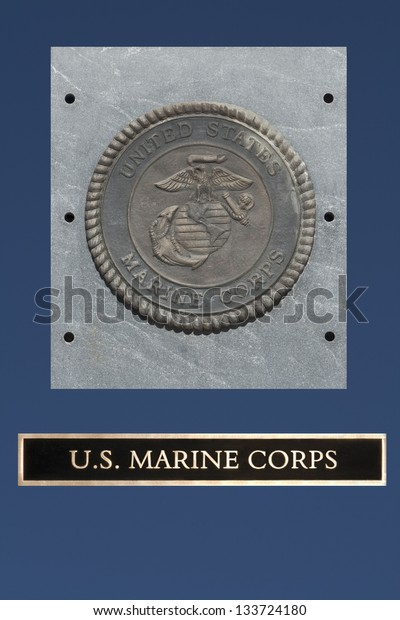US Marine Corp Emblem on granite with blue background
