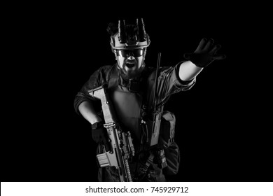 US marine corps soldiers with rifles. shot in studio. isolated on black background. (black and white)