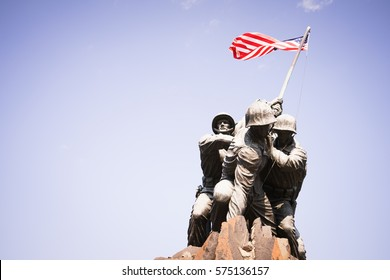 US Marine Corps War Memorial in Washington DC, USA - 16 October, 2016: Statue of soldiers putting flag