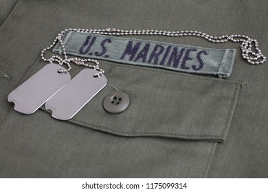 U.S. MARINES Tape with dog tags on olive green uniform background
