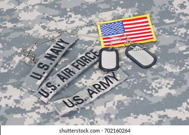 US military branch tapes whith US flag on camouflage uniform