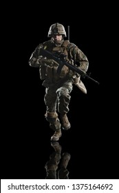 U.S. military marine. soldier. Studio shooting. running pose with reflections. isolated on black