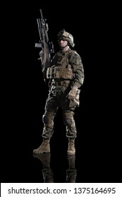 U.S. military marine. soldier. Studio shooting. Standing pose with reflections. Isolated on black.