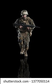 U.S. military marine. soldier. Studio shooting. running pose with reflections. Isolated on black.