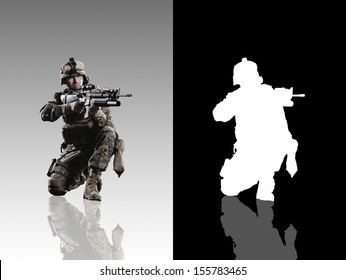 U.S. military marine. Studio shooting. with reflections. sitting pose. isolated. With alpha channel.