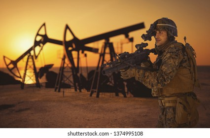 US military marines against the backdrop of the sunset. Oil industry.