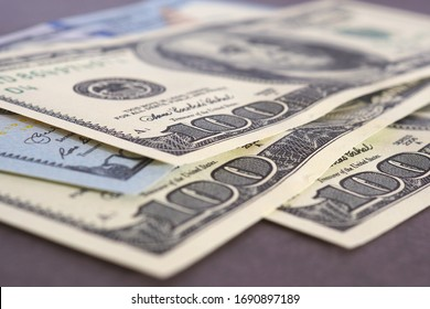 US money banknotes of 100 dollars old and new type lie on a brown paper background close-up. American economy, inflation and devaluation. National currency. Macro