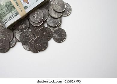 US money, hundred-dollar bills on a pile of quarters under natur - Shutterstock ID 655819795