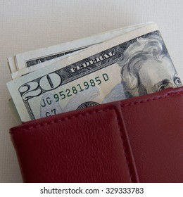 US Money in a Red Purse