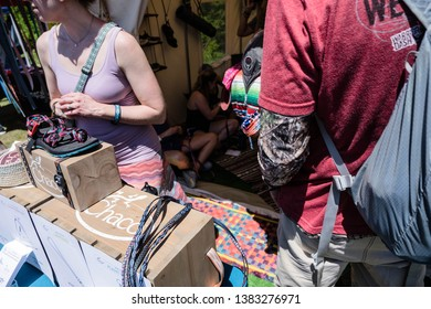 US National Whitewater Center, NC, 4/27/19; People line up to do arts and crafts at a Chaco shoes booth.