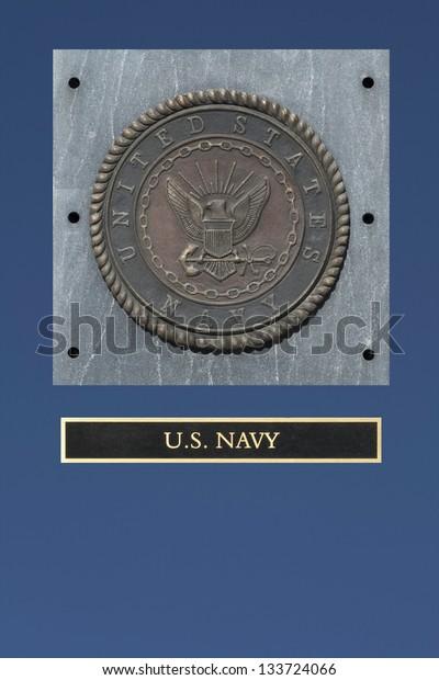 U.S. Navy emblem on granite with blue background