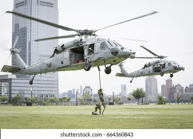 US Navy MH-60S Sea Hawk helicopters hover above Liberty State Park as U.S. Navy EOD team HSC-5 Nightdippers conduct a fast rope demonstration during Fleet Week 2017, JERSEY CITY NJ MAY 28 2017