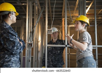US Navy sailors based in Norfolk, VA help Habitat for Humanity NYC on a home building construction project in the Brownsville section of Brooklyn during Fleet Week New York, NEW YORK MAY 25 2017.
