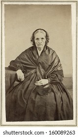 US - Ohio - CIRCA 1860 A vintage Cartes de visite photo of an elderly pioneer woman in mourning. She is dressed in a black mourning gown.  A photo from the Civil War era. CIRCA 1860