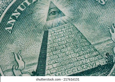 US one (1 ) dollar bill in a macro shot, super macro, close up photo. Shallow depth of field effect. Eye of Providence, all-seeing eye of God, Mason Illuminati Logo, Pyramid, Triangle. Great Seal.