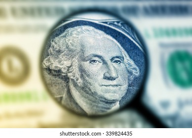 US one dollar bill under magnification glass