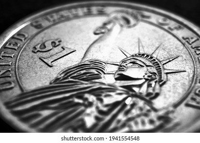 US one dollar coin close-up. Dark dramatic black and white illustration about American money, economy, finance and debt market. State benefits and government assistance. Helicopter money. Macro - Shutterstock ID 1941554548
