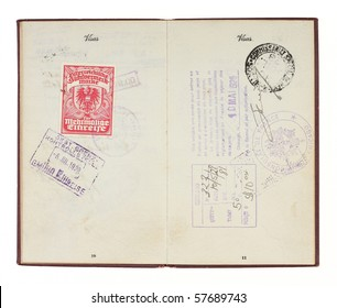 A U.S. Passport from the 1920s open to two facing pages with customs stamps from 1928 Germany and France. Isolated on white with clipping path.
