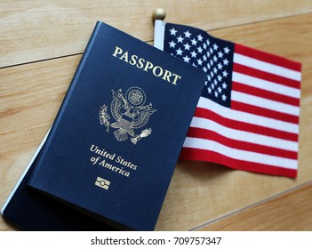 US passport and American flag, wood as background