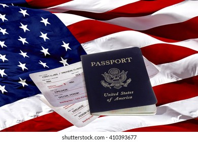 US Passport with a first class boarding pass on an American Flag