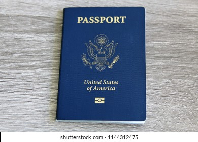 U.S. Passport with Microchip over a light grey wooden background