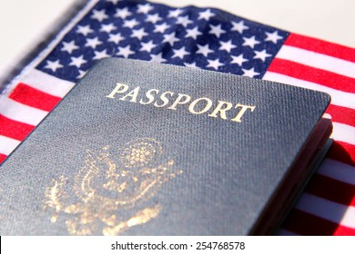 US passport over a red, white and blue flag background