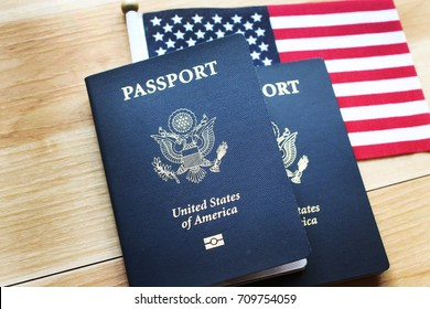 US passport wood and American flag as background