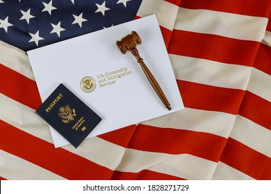 US Passports with wooden judge gavel on American flag on legal world immigration concepts a citizenship