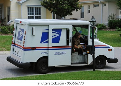 US POST VEHICLE IN SUMMERFIELD FLORIDA USA - CIRCA 2014 -United States Postal Service collection and delivery van on a residential complex in Summerfield  Florida USA