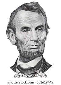 US president Abraham Abe Lincoln face portrait on USA 5 dollar bill closeup isolated, United States of America money close up.