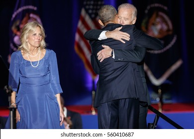 U.S. President Barack Obama hugs Vice-President Joe Biden as his wife Jill woks on after Obama delivered a farewell address at McCormick Place in Chicago, Illinois, U.S. January 10, 2017.
