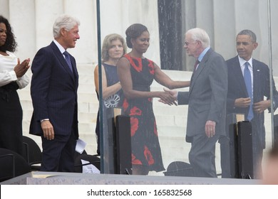 U.S. President Barack Obama, Michelle Obama, Caroline Kennedy, former president Bill Clinton, Oprah Winfrey listen to President Jimmy Carter at Lincoln Memorial August 28, 2013 in Washington, DC.