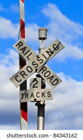 US railroad Crossing sign in front of blue sky