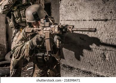 US ranger behind concrete obstacle