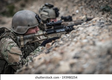 us rangers hidden in trench, during battle