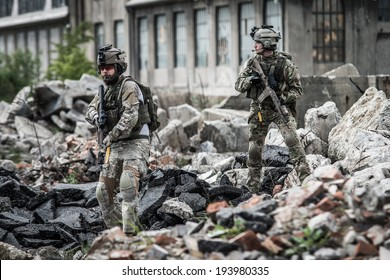 us rangers on patrol in destroyed city