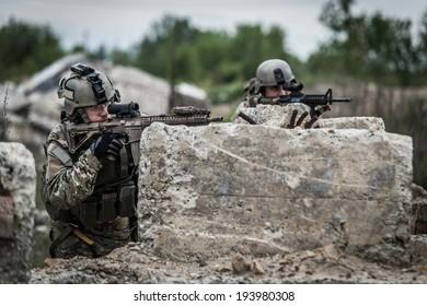 us rangers in position behind concrete blocks